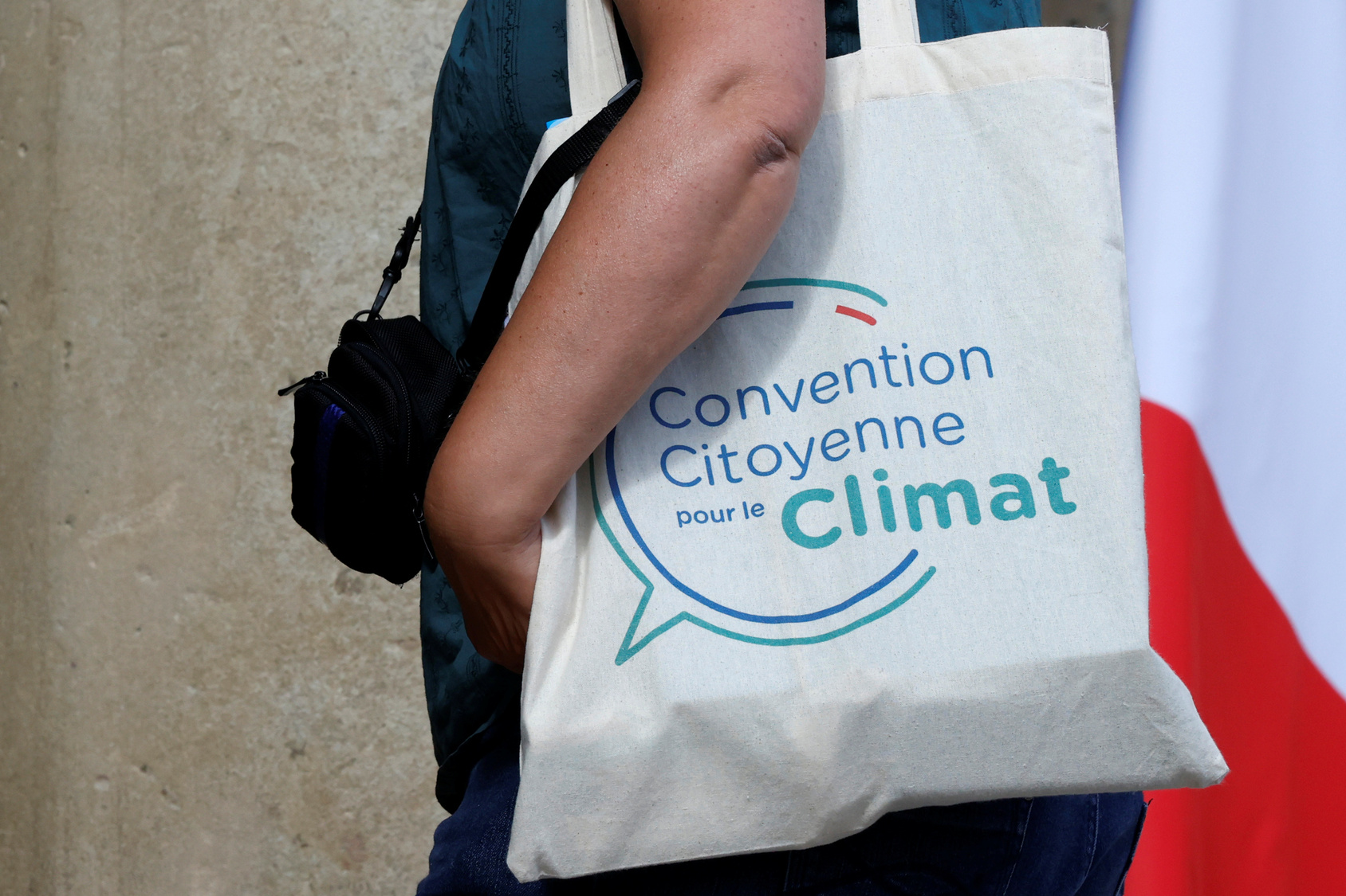 A member of the Citizens' Convention on Climate (CCC) arrives at the Elysee Palace in Paris